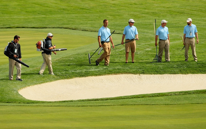 Grounds crew members at Oakmont