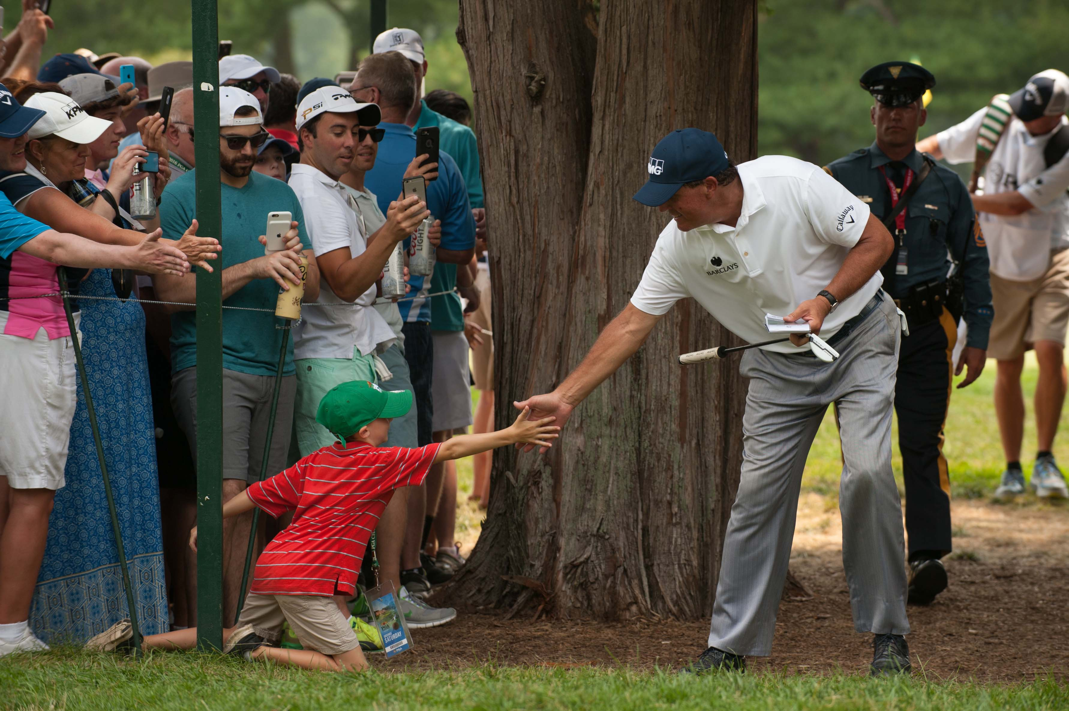 Phil shows Jason Day he has young fans, too