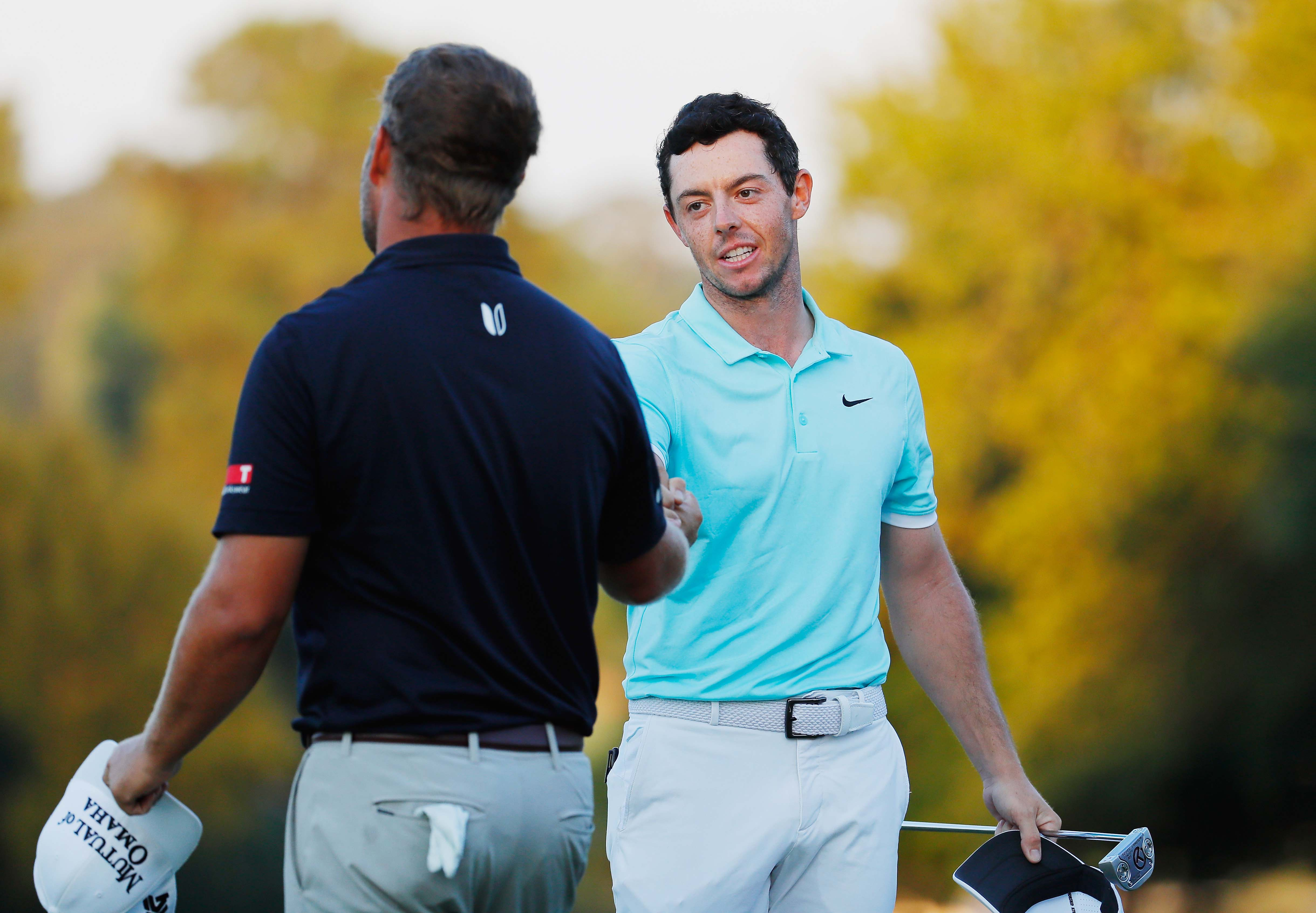 Rory McIlroy and Ryan Moore