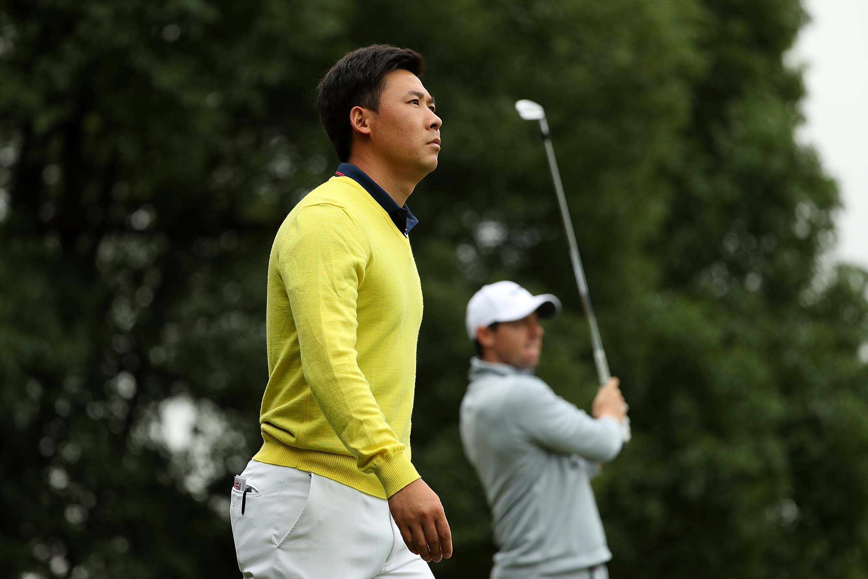 Xinjun Zhang and Rory McIlroy