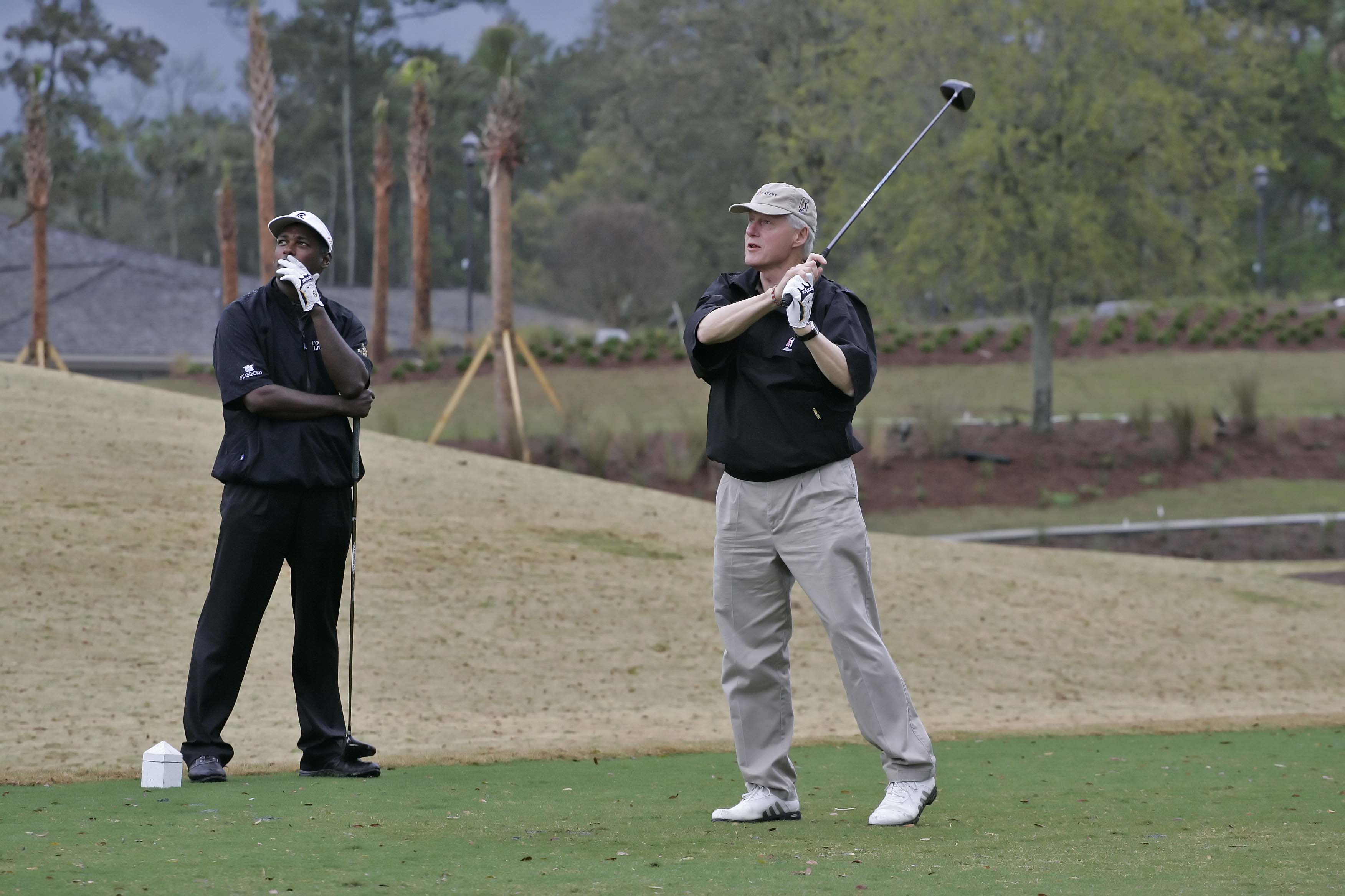 Bill Clinton and Vijay Singh