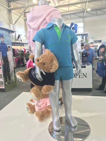 Open mannequin holding an Open teddy bear