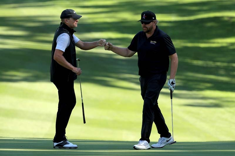 Steve Stricker and Toby Keith