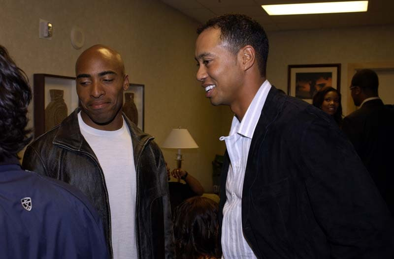 Ronde Barber and Tiger Woods