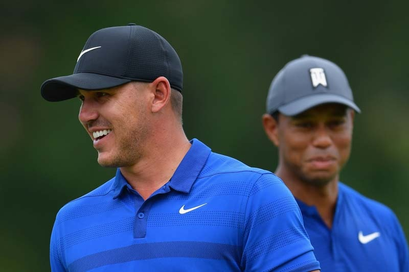 Brooks Koepka and Tiger Woods