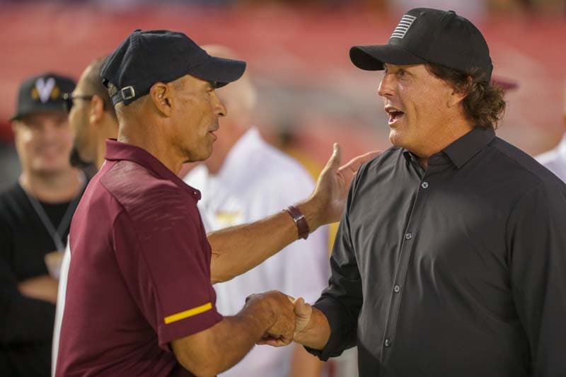 Herm Edwards and Phil Mickelson