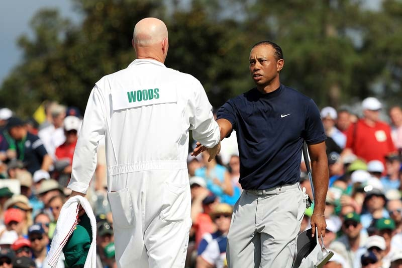 Tiger Woods of the United States and caddie Joe LaCava