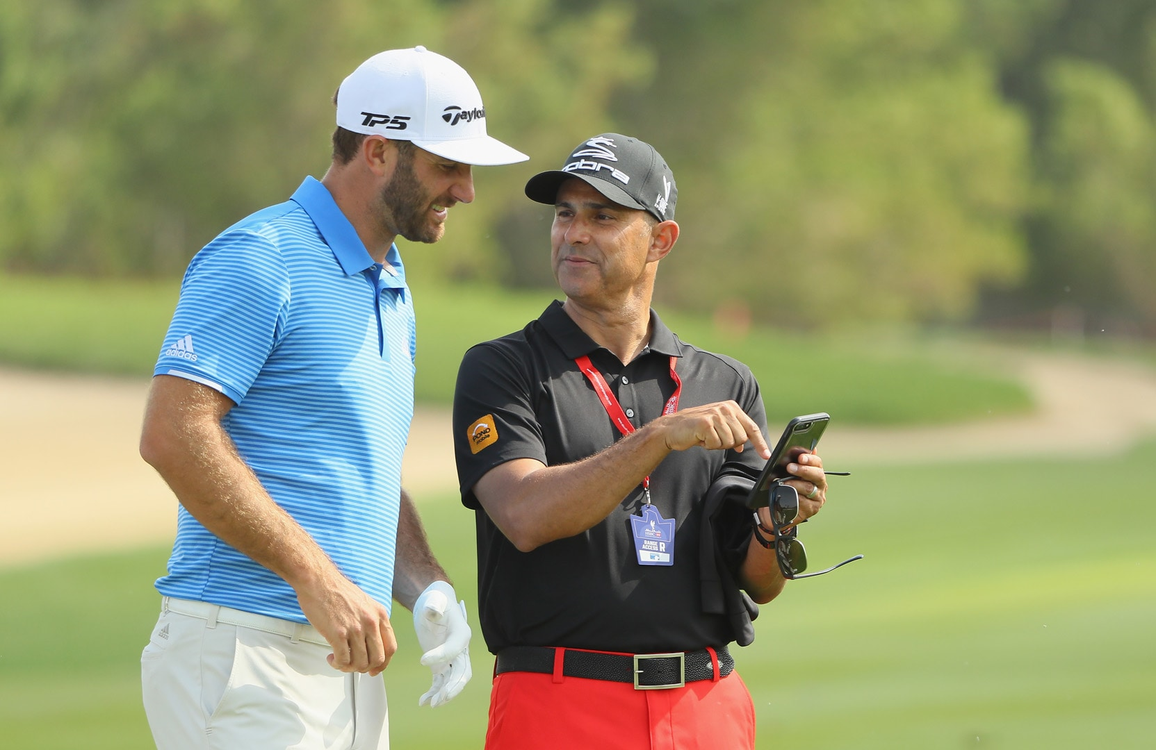 Dustin Johnson and Claude Harmon
