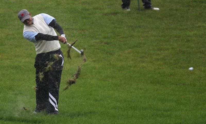 NEWPORT, WALES - OCTOBER 01:  Tiger Woods of the USA hits a shot from the rough on the first hole as the rain falls during the Morning Fourball Matches during the 2010 Ryder Cup at the Celtic Manor Resort on October 1, 2010 in Newport, Wales.  (Photo by Andy Lyons/Getty Images)