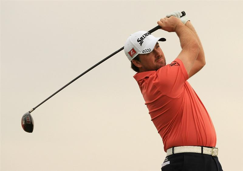 ABU DHABI, UNITED ARAB EMIRATES - JANUARY 19:  Graeme McDowell of Northern Ireland in action during the Pro Am prior to the start of The Abu Dhabi HSBC Golf Championship at Abu Dhabi Golf Club on on January 19, 2011 in Abu Dhabi, United Arab Emirates.  (Photo by Andrew Redington/Getty Images)