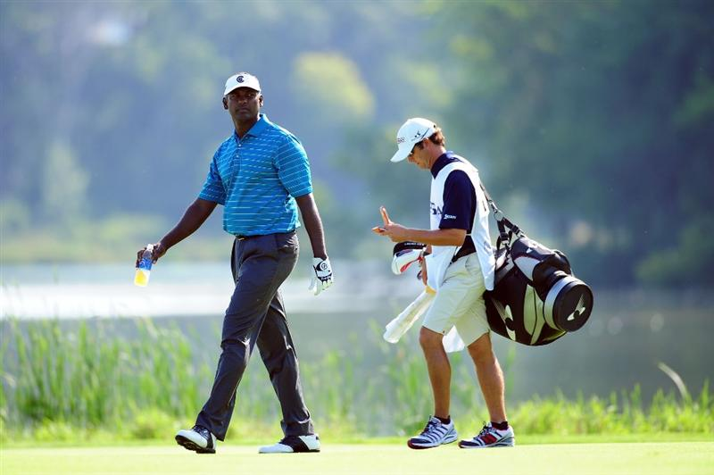 CHASKA, MN - AUGUST 14:  Vijay Singh of Fiji walks with his caddie Chad Reynolds on the 16th hole during the second round of the 91st PGA Championship at Hazeltine National Golf Club on August 14, 2009 in Chaska, Minnesota.  (Photo by Stuart Franklin/Getty Images)