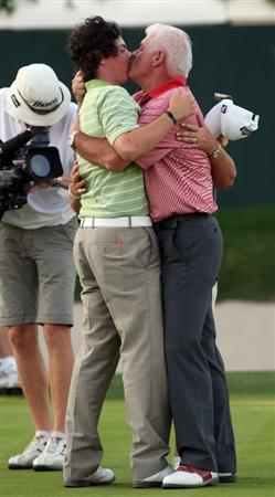 DUBAI, UNITED ARAB EMIRATES - FEBRUARY 01:  Rory McIlroy of Northern Ireland celebrates with his farther Gerry McIlroy after winning the Dubai Desert Classic. The final round of the Dubai Desert Classic played on the Majlis Course on February 1, 2009 in Dubai,United Arab Emirates.  (Photo by Ross Kinnaird/Getty Images)