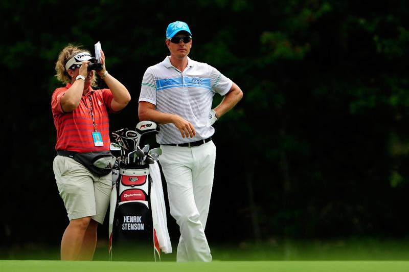 PONTE VEDRA BEACH, FL - MAY 05:  Henrik Stenson of Sweden (R) stand with caddie Fanny Sunesson during a practice round prior to the start of THE PLAYERS Championship held at THE PLAYERS Stadium course at TPC Sawgrass on May 5, 2010 in Ponte Vedra Beach, Florida.  (Photo by Sam Greenwood/Getty Images)