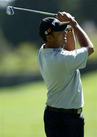 BOISE , ID - SEPTEMBER 11:  Arjun Atwal hits his second shot on the 18th hole during the first round of the Albertson's Boise Open at the Hillcrest Country Club on September 11, 2008 in Boise, Idaho.  (Photo by Jonathan Ferrey/Getty Images)