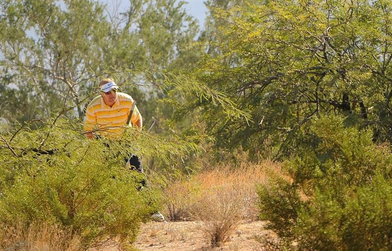 SCOTTSDALE AZ - OCTOBER 25: Richard Johnson looks over his lie in the rough on the 1st hole during the third round of  the Fry's.Com Open held at Grayhawk Golf Club on October 25, 2008 in Scottsdale, Arizona. (Photo by Marc Feldman/Getty Images)