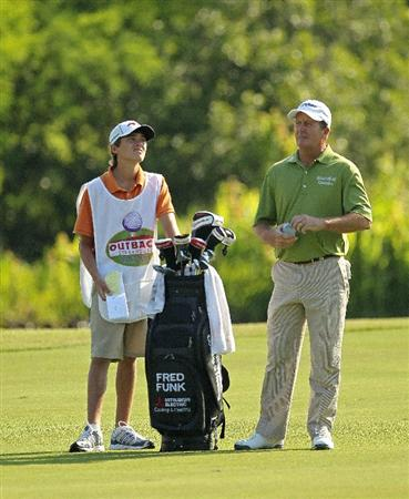 LUTZ, FL - APRIL 15:  Fred Funk (R) waits to hit his approach shot on the 11th hole during the first round of the Outback Steakhouse Pro-Am at TPC Tampa Bay on April 15, 2011 in Lutz, Florida.  (Photo by Mike Ehrmann/Getty Images)