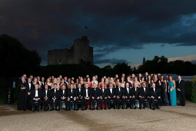 CARDIFF, WALES - SEPTEMBER 29:  The European and United States Ryder Cup teams and their wives and partners pose for an official photograph with HRH Prince Charles, The Prince of Wales before the 2010 Ryder Cup Dinner at Cardiff Castle on September 29, 2010 in Cardiff, Wales.  (Photo by Andrew Redington/Getty Images)