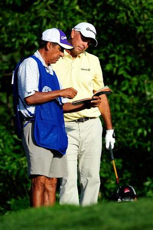 CHASKA, MN - AUGUST 13:  Tom Lehman (R) talks with his caddie Andrew Martinez on the tenth teen during the first round of the 91st PGA Championship at Hazeltine National Golf Club on August 13, 2009 in Chaska, Minnesota.  (Photo by Sam Greenwood/Getty Images)