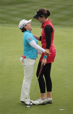 CITY OF INDUSTRY, CA - MARCH 27:  Sandra Gal of Germany (R) greets Jiyai Shin on the 18th green after Gal won the Kia Classic on March 27, 2011 at the Industry Hills Golf Club in the City of Industry, California.  (Photo by Scott Halleran/Getty Images)