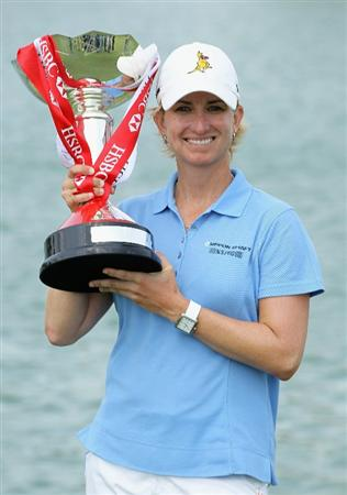 SINGAPORE - FEBRUARY 27:  Karrie Webb of Australia celebrates with the winner's trophy after her one-stroke victory at the HSBC Women's Champions 2011 at the Tanah Merah Country Club on February 27, 2011 in Singapore, Singapore.  (Photo by Scott Halleran/Getty Images)