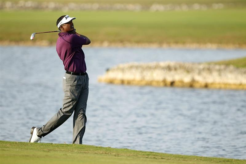 DORAL, FL - MARCH 11: Vijay Singh of Fiji plays a shot on the 18th hole during round one of the 2010 WGC-CA Championship at the TPC Blue Monster at Doral on March 11, 2010 in Doral, Florida.  (Photo by Scott Halleran/Getty Images)