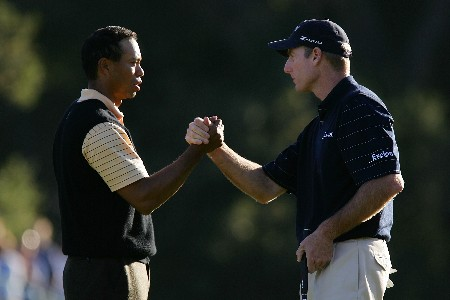 THOUSAND OAKS, CA - DECEMBER 15:  Tiger Woods and Jim Furyk shake hands on the 18th green after finishing their third round of the Target World Challenge at the Sherwood Country Club on December 15, 2007 in Thousand Oaks, California.  (Photo by Robert Laberge/Getty Images)