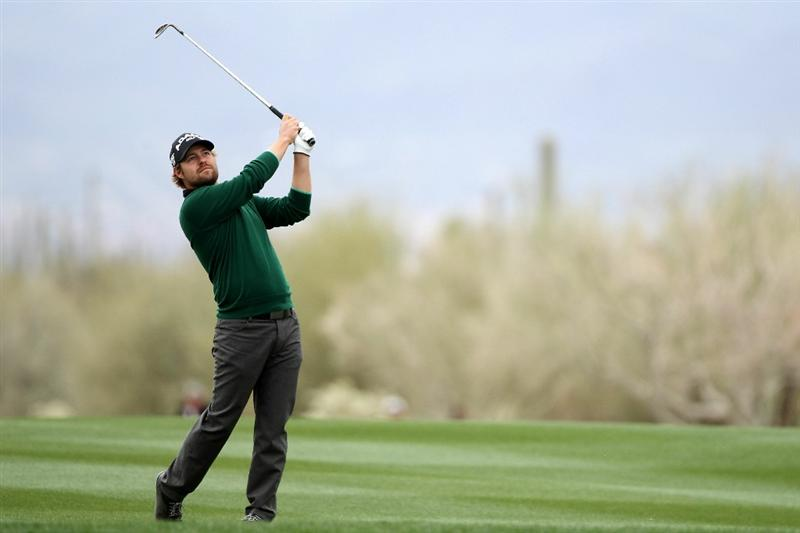MARANA, AZ - FEBRUARY 26:  Ryan Moore hits his second shot on the 14th hole during the quarterfinal round of the Accenture Match Play Championship at the Ritz-Carlton Golf Club on February 26, 2011 in Marana, Arizona.  (Photo by Andy Lyons/Getty Images)