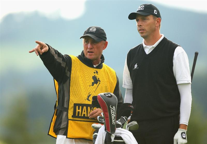 PERTH, UNITED KINGDOM - AUGUST 29:  Soren Hansen of Denmark receives some advice from his caddie John Graham on the 12th hole during the second round of The Johnnie Walker Championship at Gleneagles on August 29, 2008 at the Gleneagles Hotel and Resort in Perthshire, Scotland.  (Photo by Andrew Redington/Getty Images)