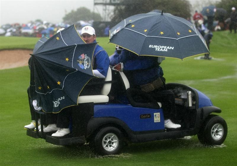 NEWPORT, WALES - OCTOBER 01:  Graeme McDowell of Europe rides on a buggy after play was suspended during the Morning Fourball Matches during the 2010 Ryder Cup at the Celtic Manor Resort on October 1, 2010 in Newport, Wales.  (Photo by Andrew Redington/Getty Images)