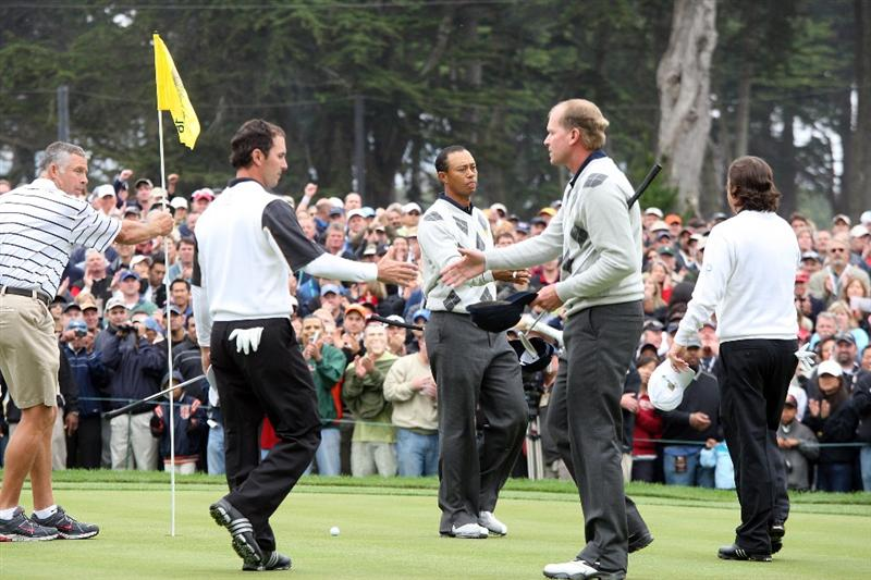 SAN FRANCISCO - OCTOBER 10: Tiger Woods and Steve Stricker of the USA Team shakes hands with their opponents Mike weir of Canada and Tim Clark of South Africa and the International Team at the 18th hole where Woods and Stricker won by one hole during the Day Three Morning Fousomes Matches in The Presidents Cup at Harding Park Golf Course on October 10, 2009 in San Francisco, California  (Photo by David Cannon/Getty Images)