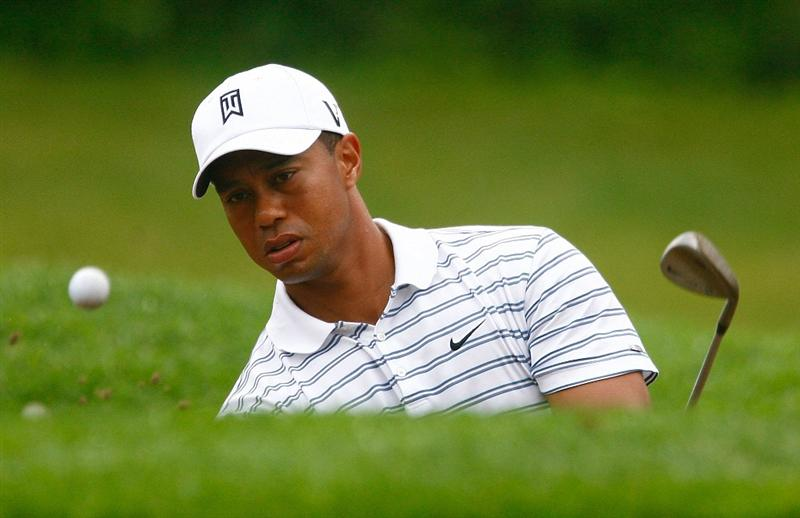 CHASKA, MN - AUGUST 10:  Tiger Woods hits a bunker shot during a practice round prior to the start of the 91st PGA Championship at the Hazeltine Golf Club on August 10, 2009 in Chaska, Minnesota.  (Photo by Scott Halleran/Getty Images)
