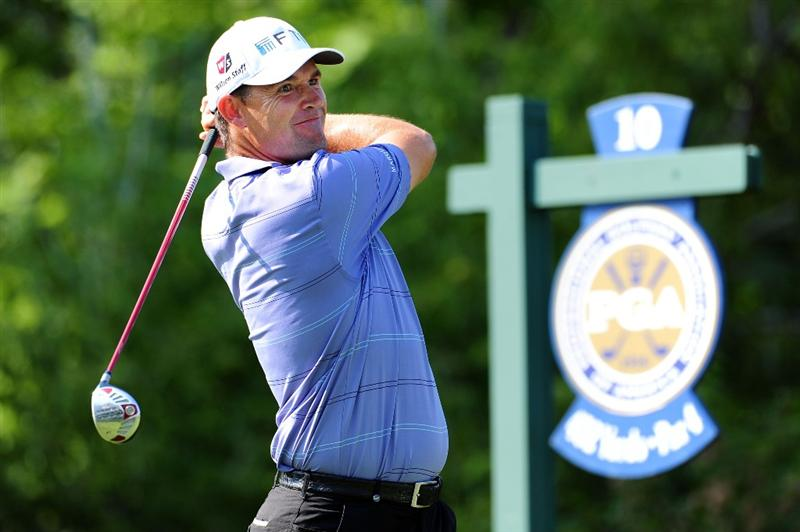 CHASKA, MN - AUGUST 14:  Padraig Harrington of Ireland hits his tee shot on the tenth hole during the second round of the 91st PGA Championship at Hazeltine National Golf Club on August 14, 2009 in Chaska, Minnesota.  (Photo by Stuart Franklin/Getty Images)