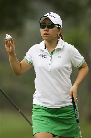 CHON BURI, THAILAND - FEBRUARY 20:  Mika Miyazato of Japan acknowledges the crowd on the 8th green during round three of the Honda PTT LPGA Thailand at Siam Country Club on February 20, 2010 in Chon Buri, Thailand.  (Photo by Victor Fraile/Getty Images)