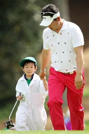 AUGUSTA, GA - APRIL 07:  Y.E. Yang of South Korea walks to a green with his caddie during the Par 3 Contest prior to the 2010 Masters Tournament at Augusta National Golf Club on April 7, 2010 in Augusta, Georgia.  (Photo by Jamie Squire/Getty Images)