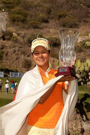 MORELIA, MEXICO - MAY 2: Ai Miyazato of Japan poses with the champion's trophy following the fourth round of the Tres Marias Championship at the Tres Marias Country Club on May 2, 2010 in Morelia, Mexico. (Photo by Darren Carroll/Getty Images)