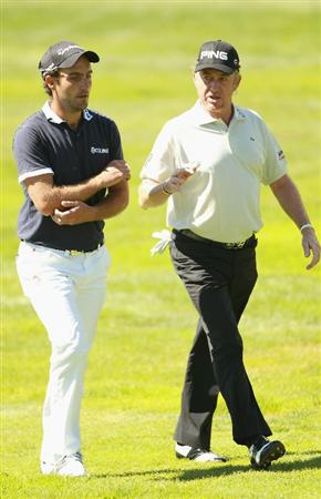 CRANS, SWITZERLAND - SEPTEMBER 04:  Edoardo Molinari of Italy speaks with Miguel Angel Jimenez of Spain during the third round of The Omega European Masters at Crans-Sur-Sierre Golf Club on September 4, 2010 in Crans Montana, Switzerland.  (Photo by Warren Little/Getty Images)