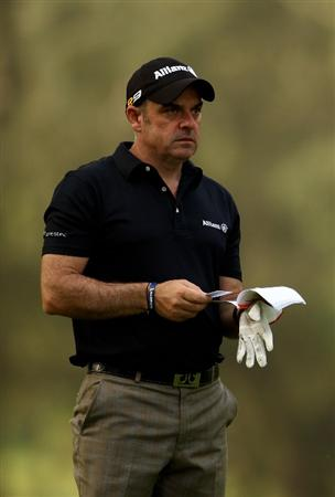 RABAT, MOROCCO - MARCH 18:  Paul McGinley of Ireland looks at his yardage book during the first round of the Hassan II Golf Trophy at Royal Golf Dar Es Salam on March 18, 2010 in Rabat, Morocco.  (Photo by Richard Heathcote/Getty Images)