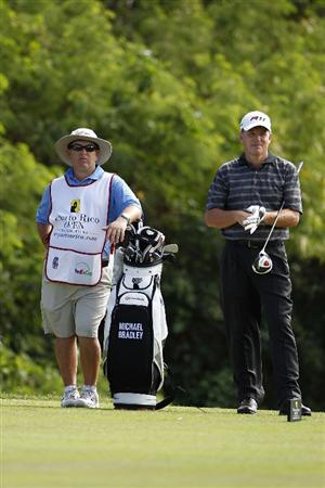 RIO GRANDE, PR - MARCH 13:  Michael Bradley (R) stands by his golf bag on the 15th tee box during the final round of the Puerto Rico Open presented by seepuertorico.com at Trump International Golf Club on March 13, 2011 in Rio Grande, Puerto Rico.  (Photo by Michael Cohen/Getty Images)