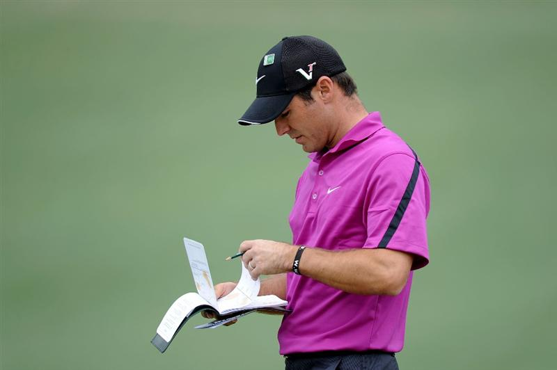 AUGUSTA, GA - APRIL 08:  Trevor Immelman of South Africa at his yardage book on the second hole during the first round of the 2010 Masters Tournament at Augusta National Golf Club on April 8, 2010 in Augusta, Georgia.  (Photo by Harry How/Getty Images)