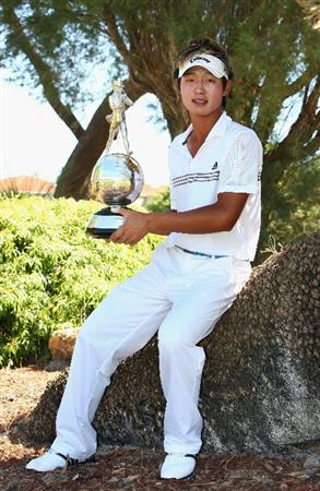 PERTH, AUSTRALIA - FEBRUARY 22:  Danny Lee of New Zealand poses with the trophy after winning the 2009 Johnnie Walker Classic at The Vines Resort and Country Club on February 22, 2009 in Perth, Australia.  (Photo by Ian Walton/Getty Images)