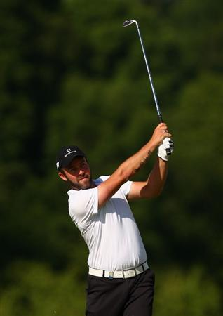 ST OMER, FRANCE - JUNE 18:  Christian Nilsson of Sweden plays an iron shot during Round One of the Open de St Omer at the AA St Omer Golf Club on June 18, 2009 in St Omer, France.  (Photo by Ryan Pierse/Getty Images)