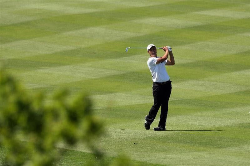 ASH, UNITED KINGDOM - MAY 31: Simon Khan of England hits his second shot at the 18th hole during the final round of the 2009 European Open at the London Golf Club on May 31, 2009 in Ash, England  (Photo by David Cannon/Getty Images)