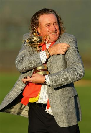 NEWPORT, WALES - OCTOBER 04:  European Team member Miguel Angel Jimenez poses with the Ryder Cup following Europe's 14.5 to 13.5 victory over the USA at the 2010 Ryder Cup at the Celtic Manor Resort on October 4, 2010 in Newport, Wales.  (Photo by Andy Lyons/Getty Images)