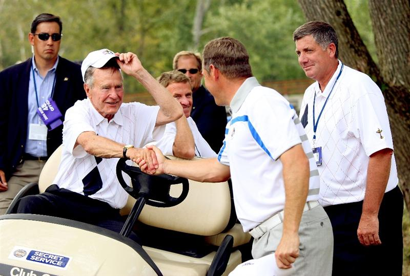 LOUISVILLE, KY - SEPTEMBER 19:  Former President George H.W. Bush meets Lee Westwood as PGA of America president Brian Whitcomb looks on during the afternoon four-ball matches on day one of the 2008 Ryder Cup at Valhalla Golf Club on September 19, 2008 in Louisville, Kentucky.  (Photo by Andrew Redington/Getty Images)