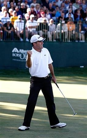BOISE, ID - SEPTEMBER 20:  Fran Quinn pumps his fist after making a birdie putt to win the Albertson's Boise Open at Hillcrest Country Club on September 20, 2009 in Boise, Idaho.  (Photo by Jonathan Ferrey/Getty Images)