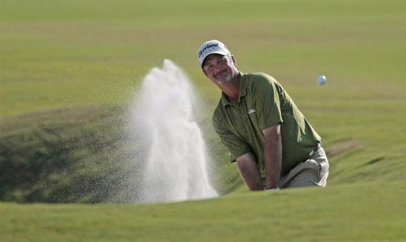 AVONDALE, LA - APRIL 25: Jerry Kelly hits from a fairway bunker on the 18th hole during the third round of the Zurich Classic at TPC Louisiana on April 25, 2009  in Avondale, Louisiana. (Photo by Dave Martin/Getty Images)