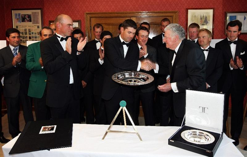 WENTWORTH, ENGLAND - MAY 19:  Padraig Harrington of Ireland (C) is presented with the Players' Player Award by Thomas Bjorn of Denmark (L) and John Jacobs (R) of England during The Tour Dinner at  the BMW PGA Championship at Wentworth on May 19, 2009 in Virginia Water, England.  (Photo by Andrew Redington/Getty Images)