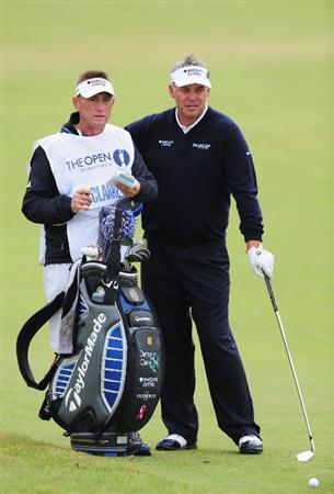 TURNBERRY, SCOTLAND - JULY 18:  Darren Clarke of Northern Ireland lines up a shot with caddy John Graham during round three of the 138th Open Championship on the Ailsa Course, Turnberry Golf Club on July 18, 2009 in Turnberry, Scotland.  (Photo by Stuart Franklin/Getty Images)