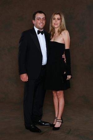 NEWPORT, WALES - SEPTEMBER 29:  Francesco Molinari of the European Ryder Cup team poses with his wife Valentina prior to the 2010 Ryder Cup Dinner at the Celtic Manor Resort on September 29, 2010 in Newport, Wales.  (Photo by David Cannon/Getty Images)