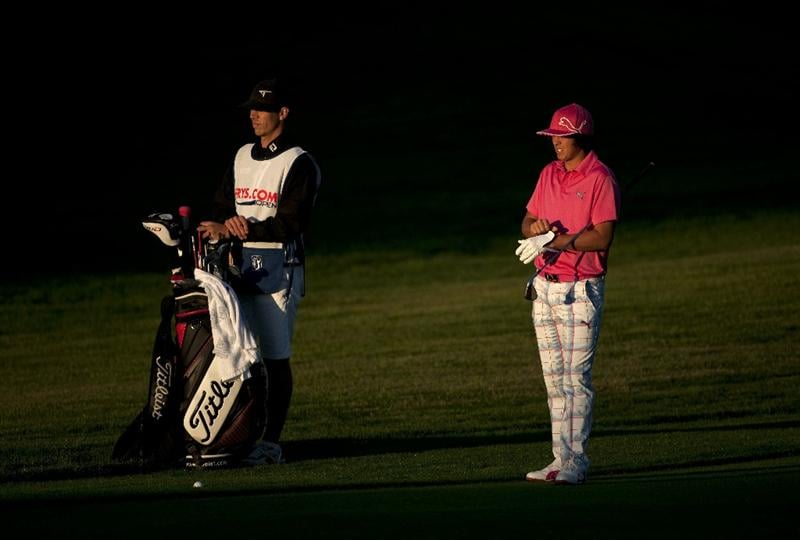 SAN MARTIN, CA - OCTOBER 14:  Rickie Fowler stands next to his golf bag and his caddie Joe Skovron on the 10th fairway during the first round of the Frys.com Open at the CordeValle Golf Club on October 14, 2010 in San Martin, California.  (Photo by Robert Laberge/Getty Images)